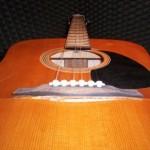 Atlīmējies ģitāras tiltiņš